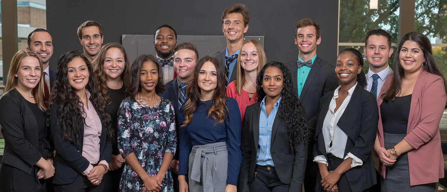 group photo of young adults in business professional attire