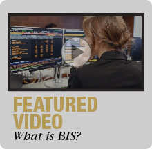 photo of the back of a students head, looking at a computer, with a play arrow, says featured video what is BIS?