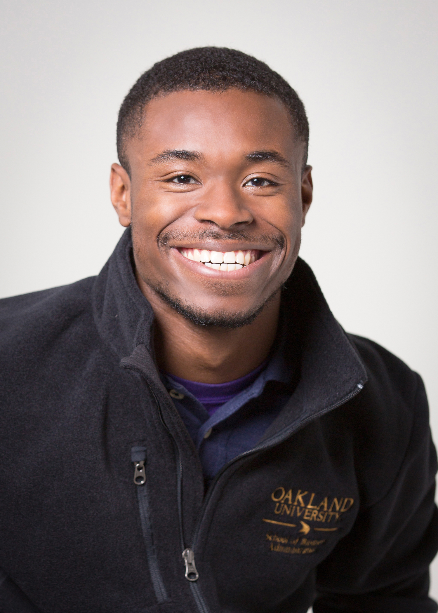 Destin Eddington, business school adviser. Image of African American man smiling, wearing black OU shirt.
