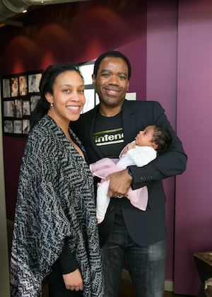 Tramale Turner with his wife, holding his infant daughter