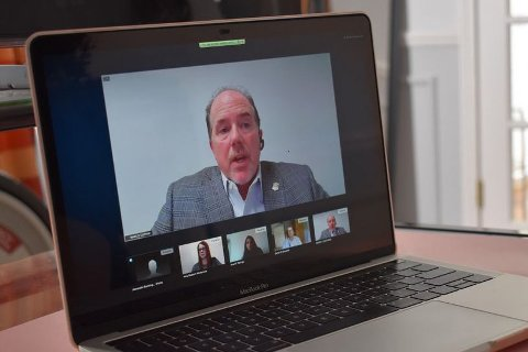 Mark Guthrie, CIO and director, AM General, on a laptop computer screen in a video conference.