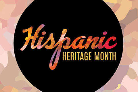 Hispanic Heritage Month written in rainbow colored cursive on a black circle background