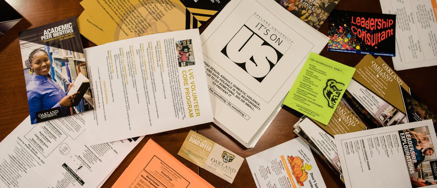 Table covered in a variety of forms and flyers