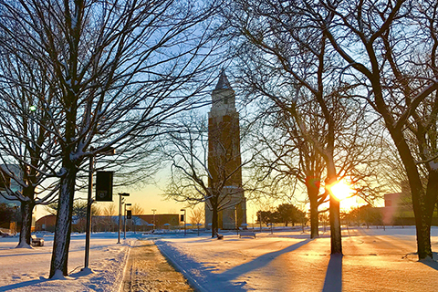 Elliott Tower on Oakland University campus at sunrise with snow on the ground