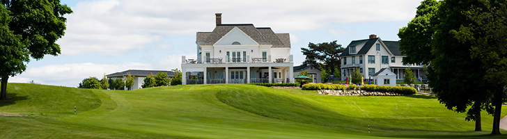image of the back of the Steve Sharf Clubhouse building from the perspective of the greens