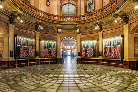 U.S. flags along decorative walls at the Capitol building in Lansing, MI