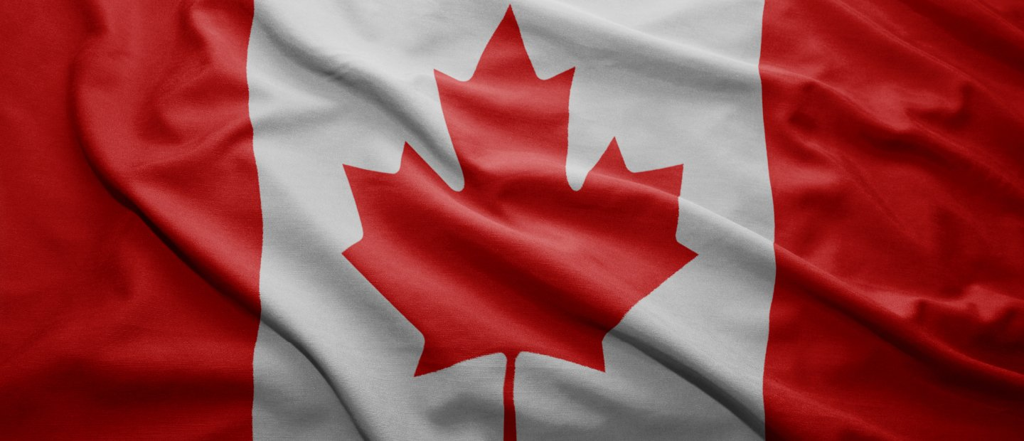 Canadian flag, red maple leaf centered on a white background with red section to the left and right