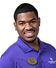 Headshot of Keo Townsend in a purple shirt and name tag
