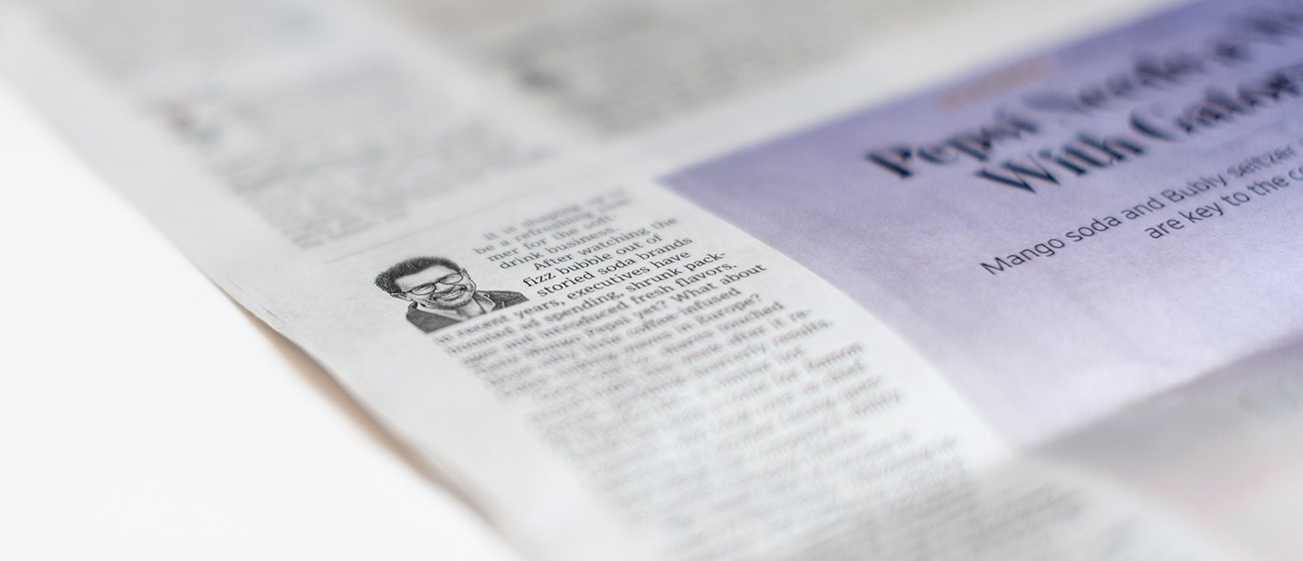 photo of a newspaper column with a man's face at the top