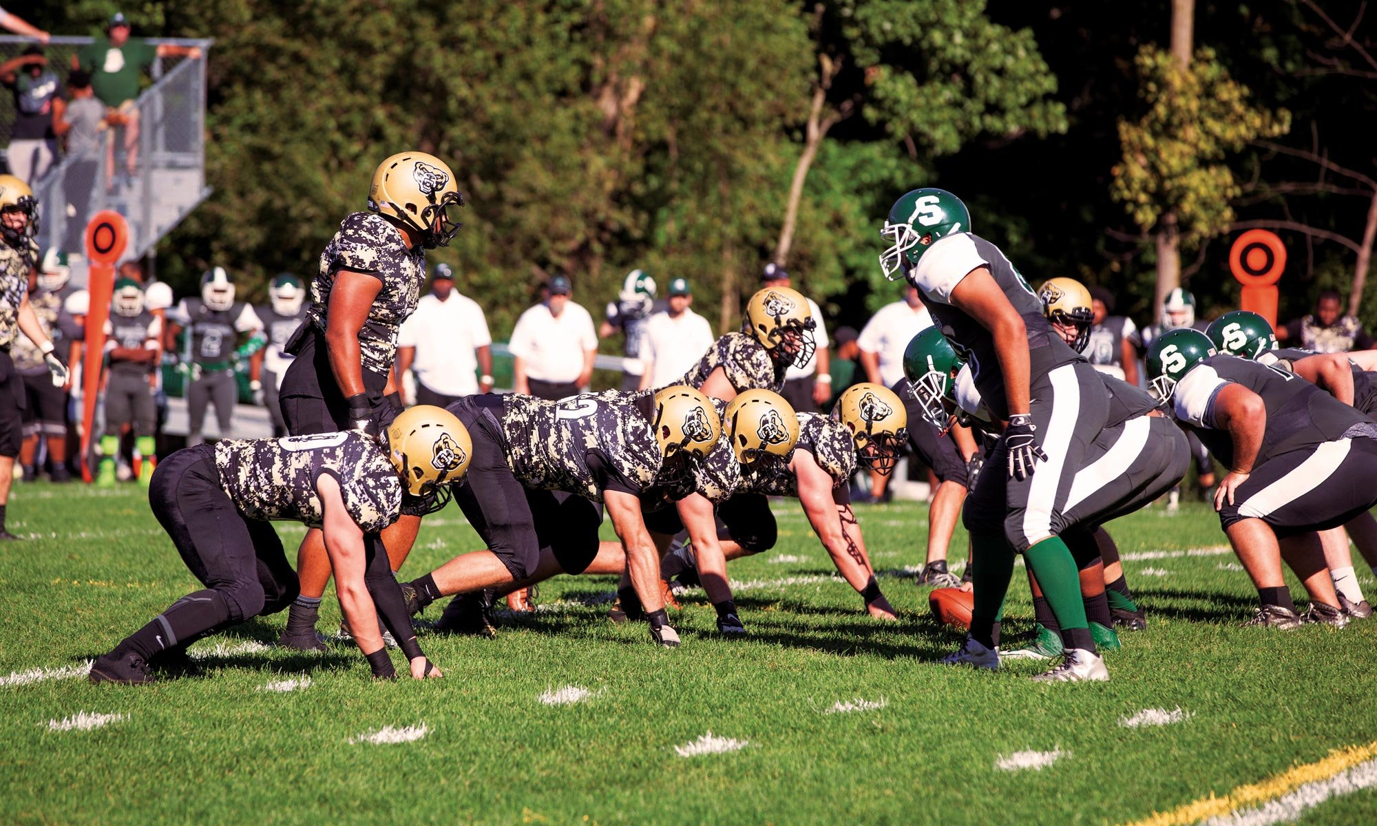 An action shot of Oakland University's club football team playing against Michigan State's club team