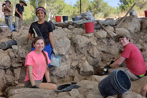 three students on an archaeological dig in Israel