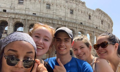 five students in front of the Colosseum in Italy
