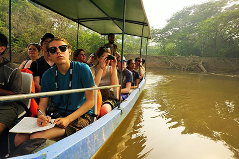 O U study abroad students in a boat on a river, participating in the Tropical Ecology in Costa Rica program