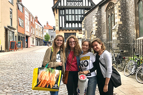 OU study abroad student and friends in Norwich, England.