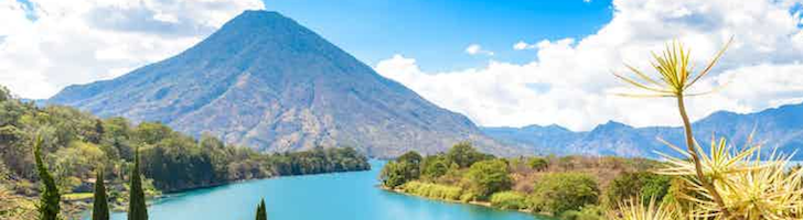 bright blue lake with mountains in the background in Guatemala