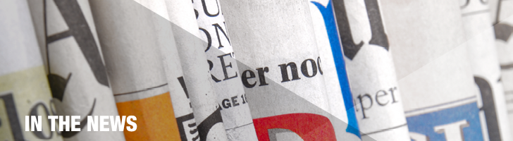 banner image displaying a photograph of multiple folded newspapers