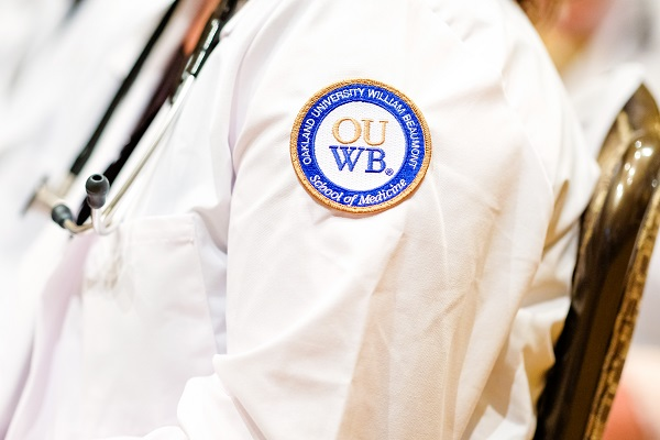 A close-up of the OUWB patch on a white coat.