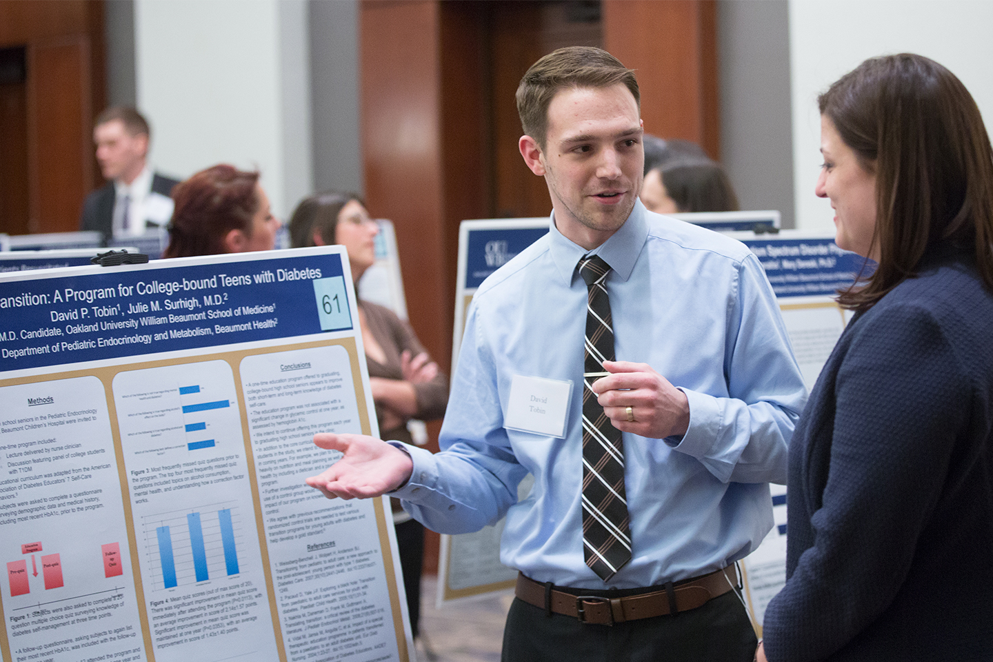 David Tobin explains research to Biomedical Science faculty Kara Sawarynski, Ph.D.
