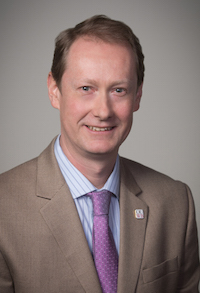 Headshot of Stefan Walter, Ph.D. in a brown jacket