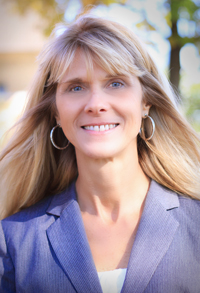 Headshot of Virginia Uhley, Ph.D. wearing a blue blazer