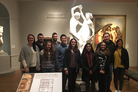 group of students standing in front of a white sculpture and a painting on the wall at the Detroit Institute of Art