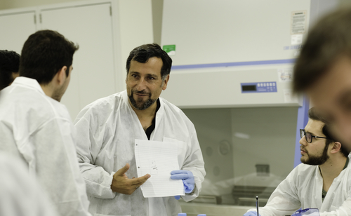 An image of Claudio Cortes in OUWB's microbiology lab