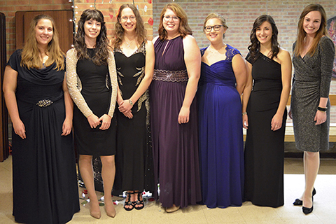 seven women in formal dresses at the flute studio recital