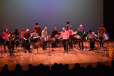 people playing various percussion instruments on stage at the Percussion Ensemble Concert