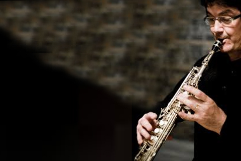 Jean-Michael Goury playing the saxophone