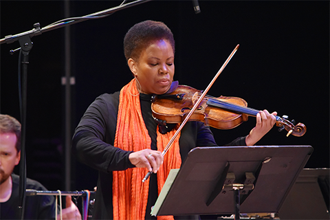 Regina Carter playing the violin with the O U Jazz band