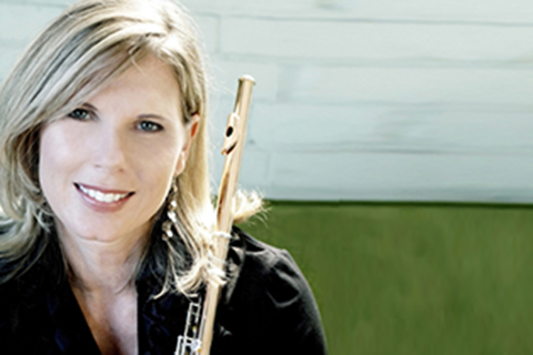 Headshot of Sharon Sparrow holding a flute