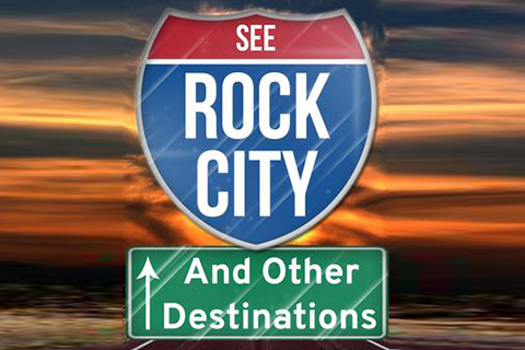 Red and blue road sign that says See Rock City on top of a green road sign that says And Other Destinations with upward facing arrow