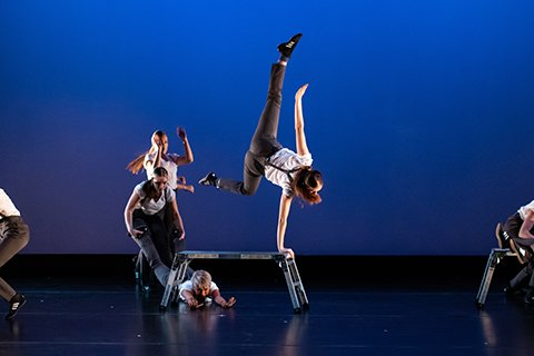 dancers performing acrobatic moves on stage