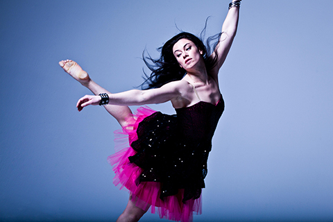 Elizabeth Riga dancing in a black dress with pink tulle at the bottom