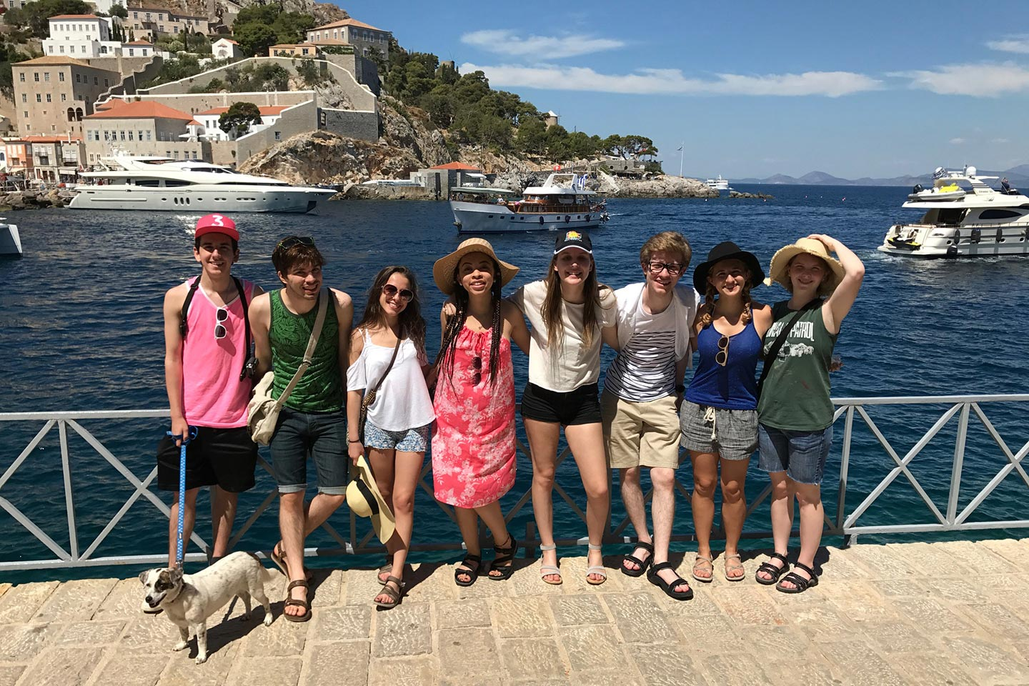 Students Mark Ujkstivani, Joel Hunter, Lily Talevski, Jordan Taylor, Natalie Manor, Noah Fillion, Alaina Whidby, Erin Wiley at Hydra port in Greece