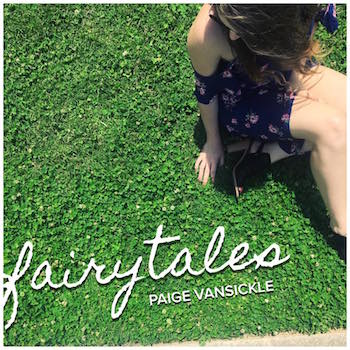 Album cover that says fairytales, paige vansickle, with an image of Paige VanSickle sitting in the grass