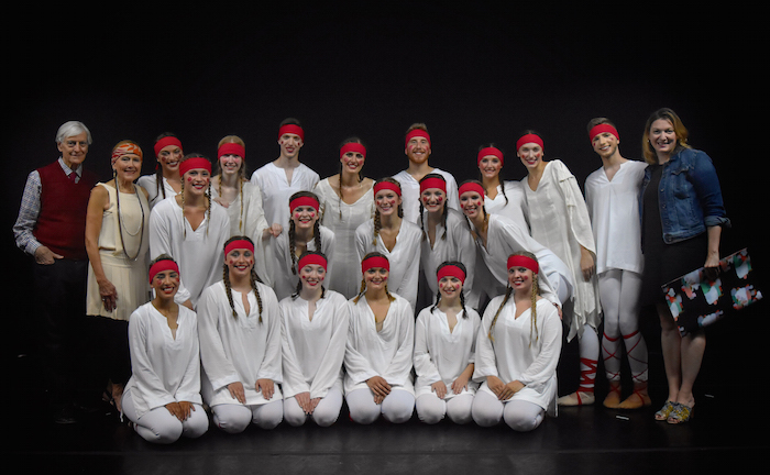 O U dance students and instructors in a group photo for The Rite of Spring in white robes with red headbands