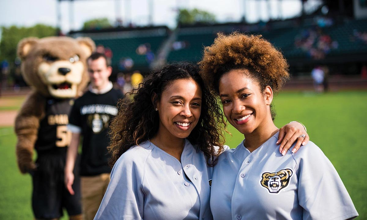 Oakland University supporters pose for a photo at Jimmy John's Field