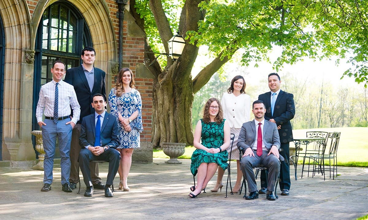 The graduates honored at the Oakland University Young Alumni Association's 10 Within 10 Awards stand outside of Meadow Brook Hall