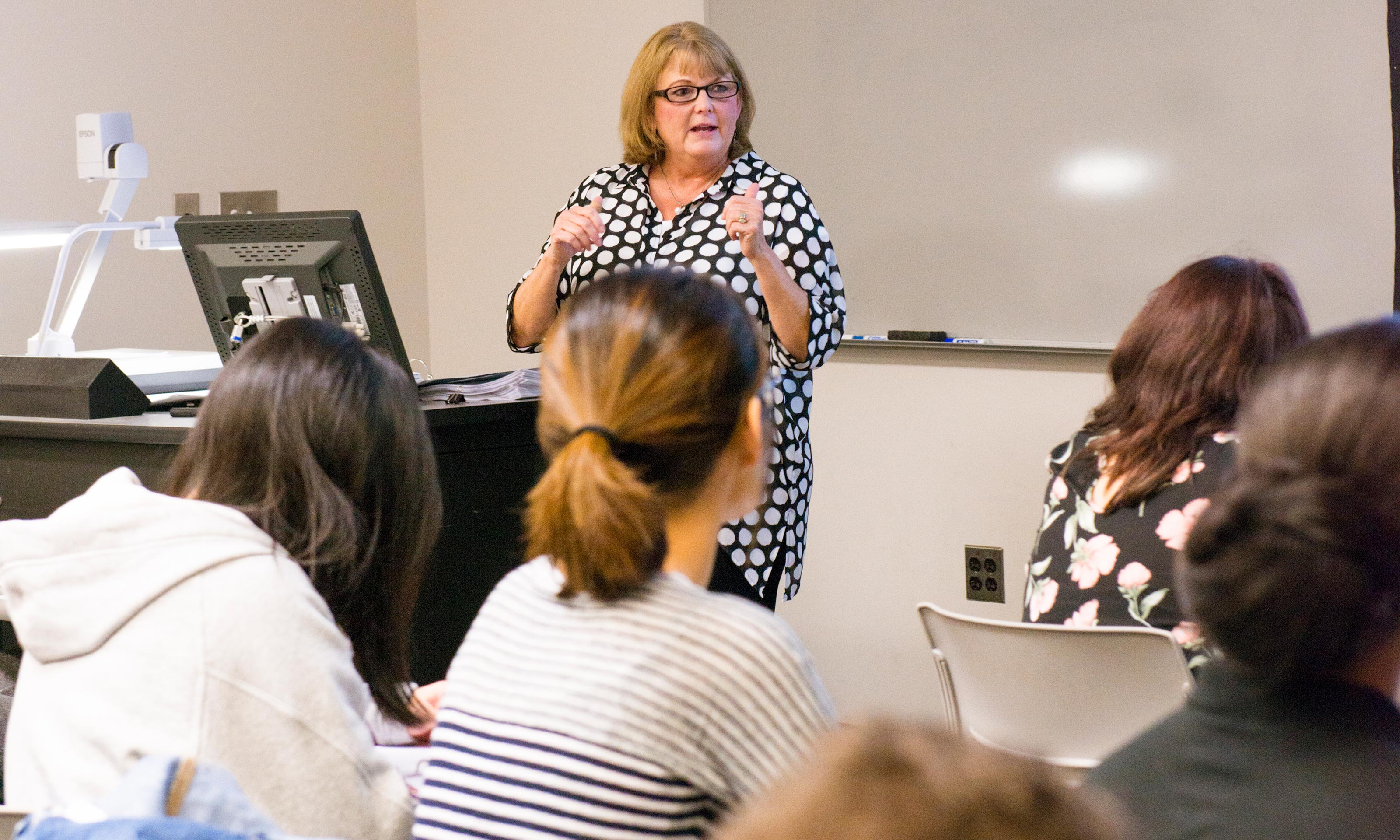 Oakland University professor Donna Free teaches a class