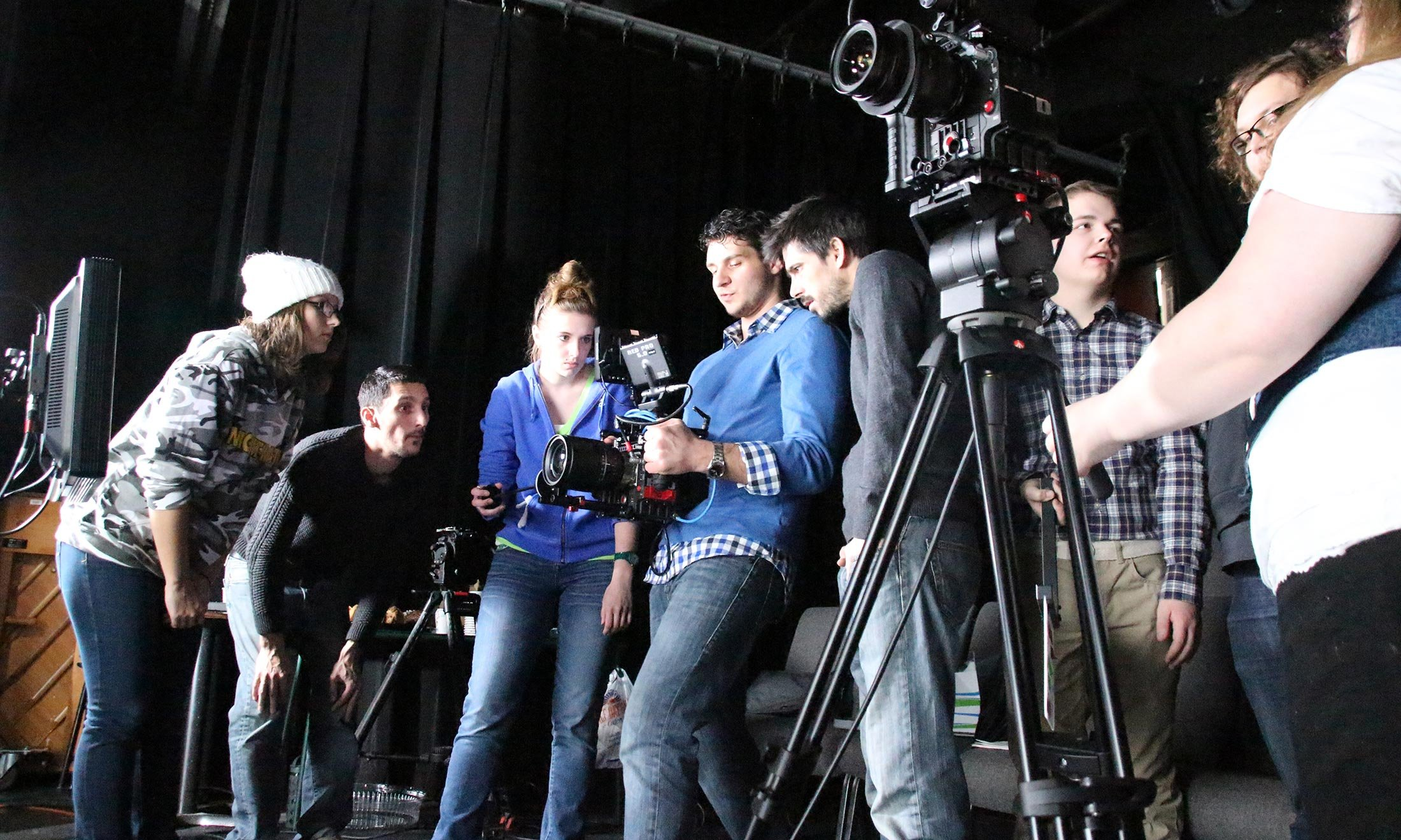 Oakland University film students help direct a shoot in the production room