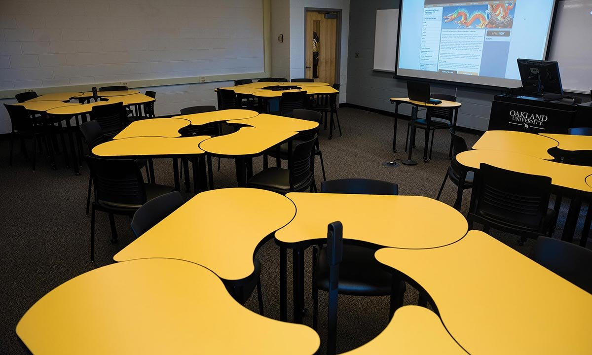 Department of Modern languages and Literatures classroom full of yellow desks with plugs for power