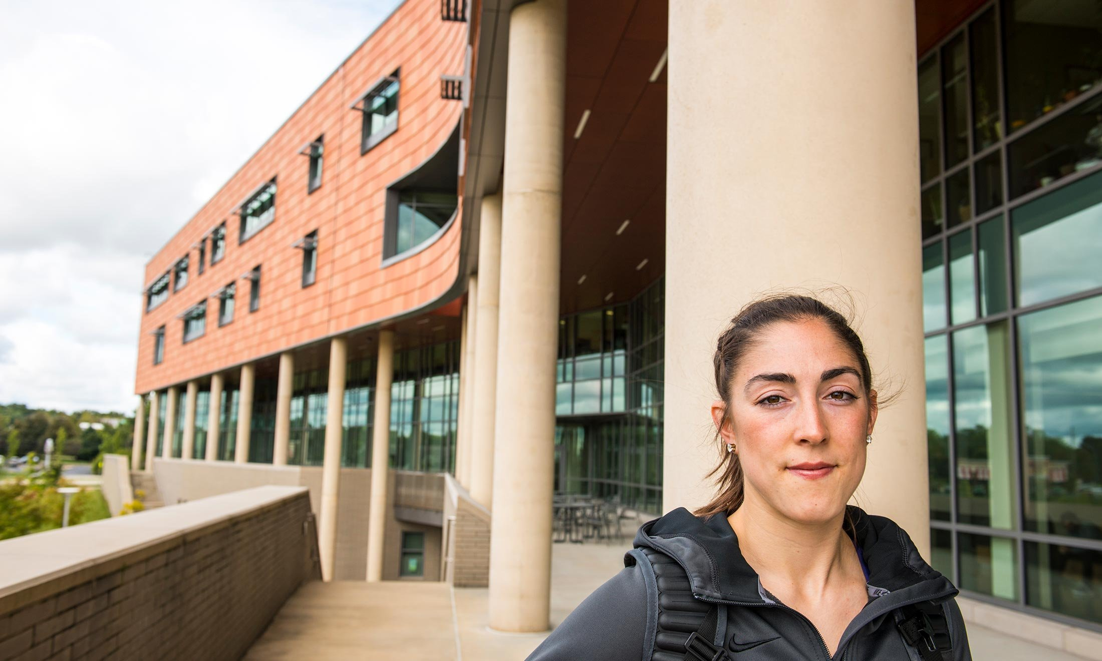 Oakland University women's basketball player Taylor Gleason outside of the Human Health Building at O U