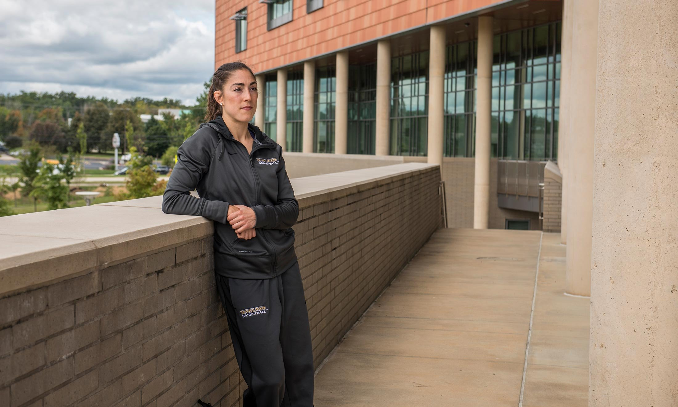 Oakland University women's basketball player Taylor Gleason stands in front of the Human Health building