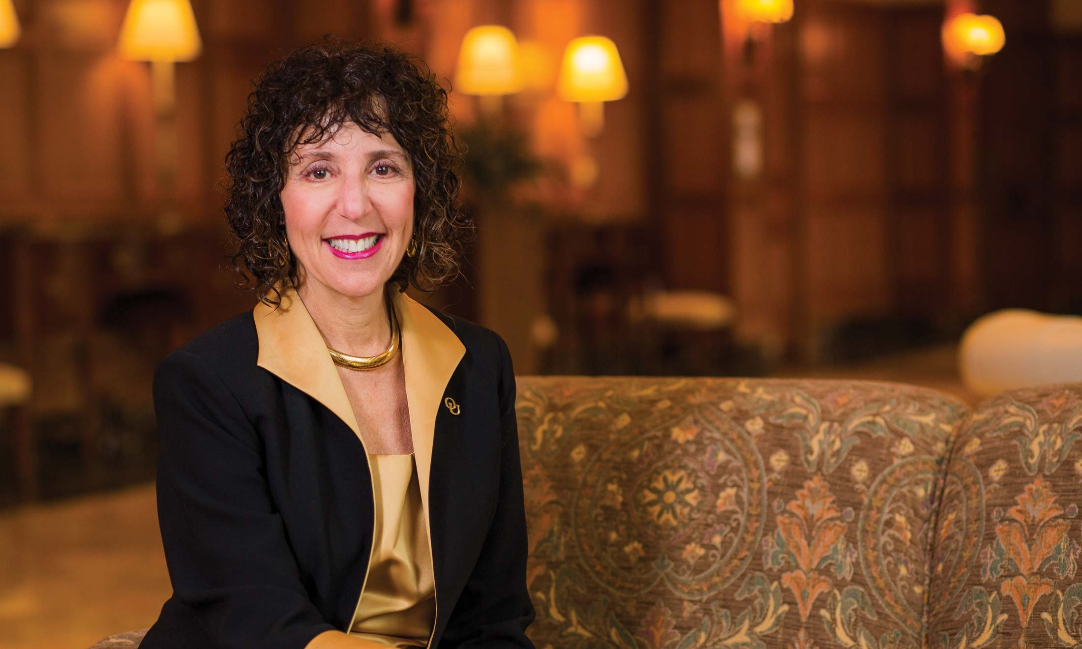 Dr. Ora Hirsch Pescovitz, Oakland University's seventh president sitting on a couch