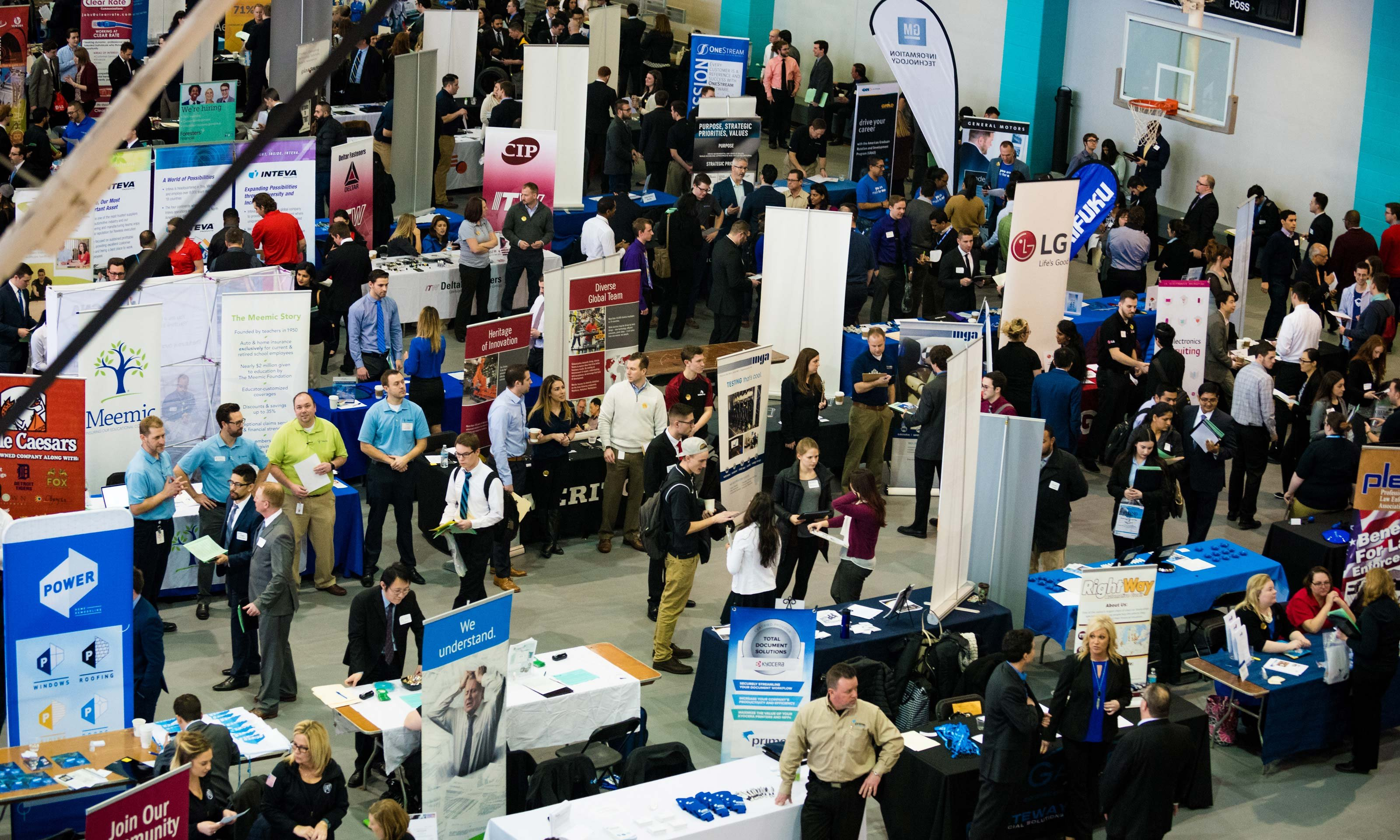 Guests walking around and vendors at tables at the Winter Career Fair hosted by Career Services on Jan. 25, 2017