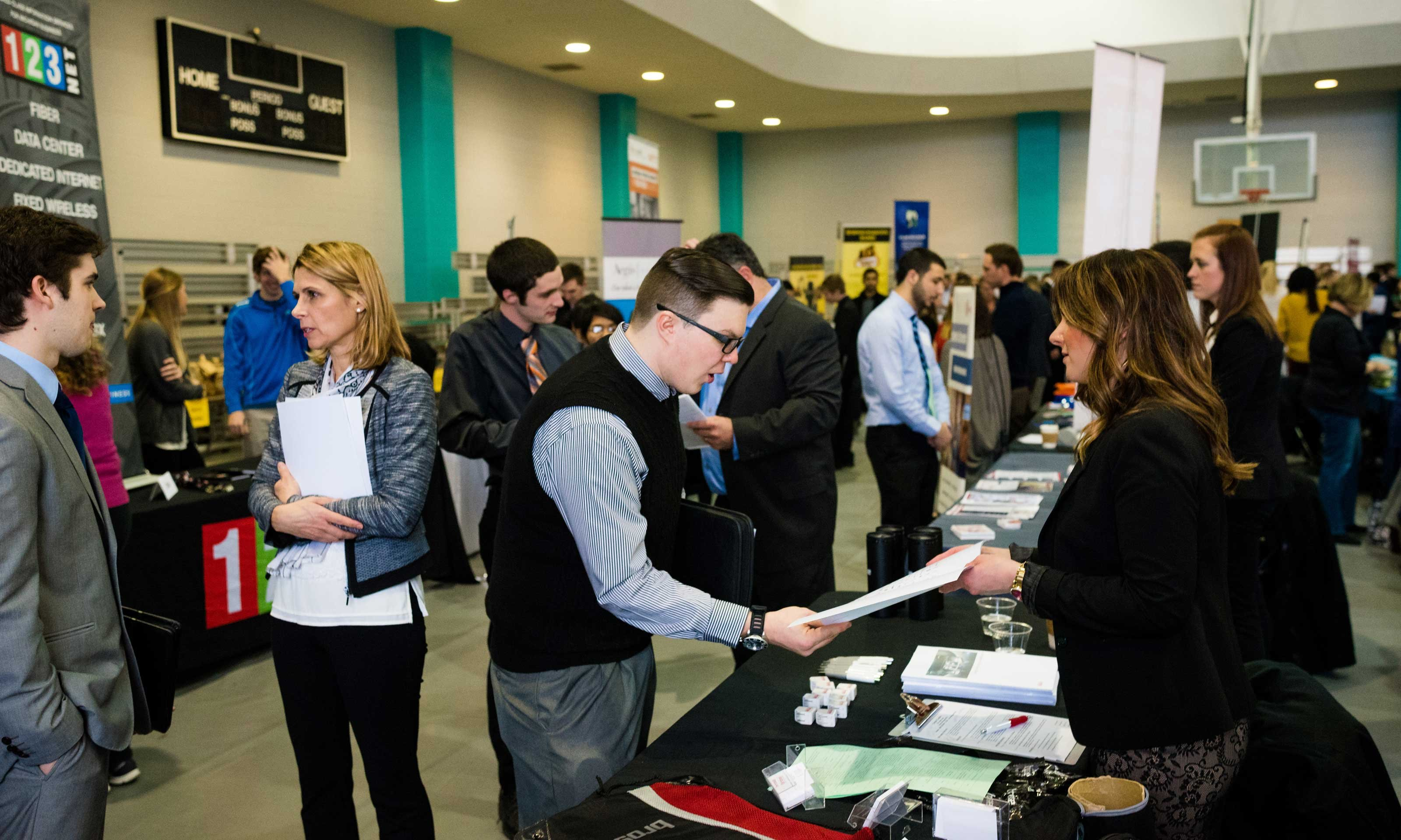 Students and alumni talking with employers at the Winter Career Fair hosted by Career Services on Jan. 25, 2017