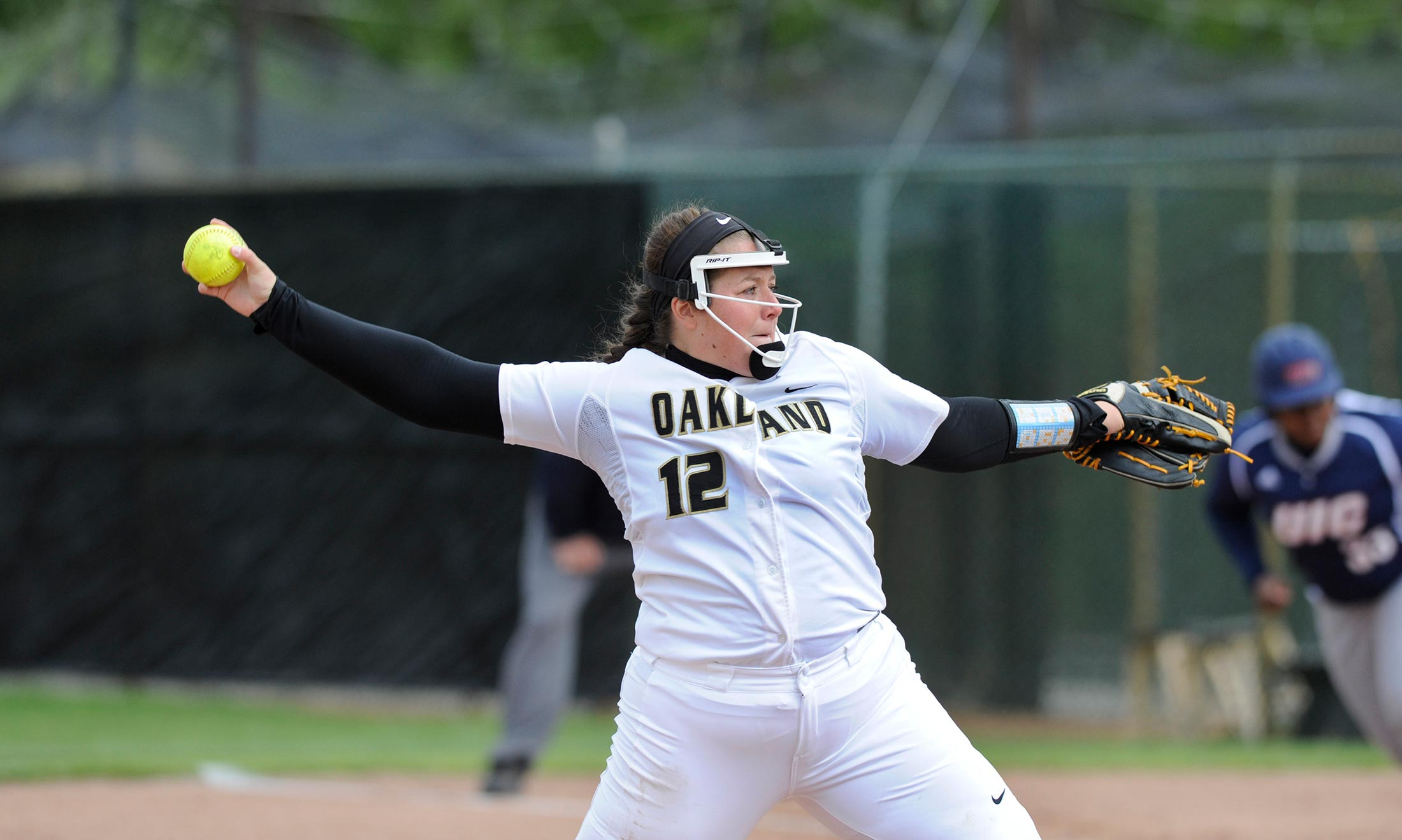 Oakland University softball star Erin Kownacki throws a pitch during a game