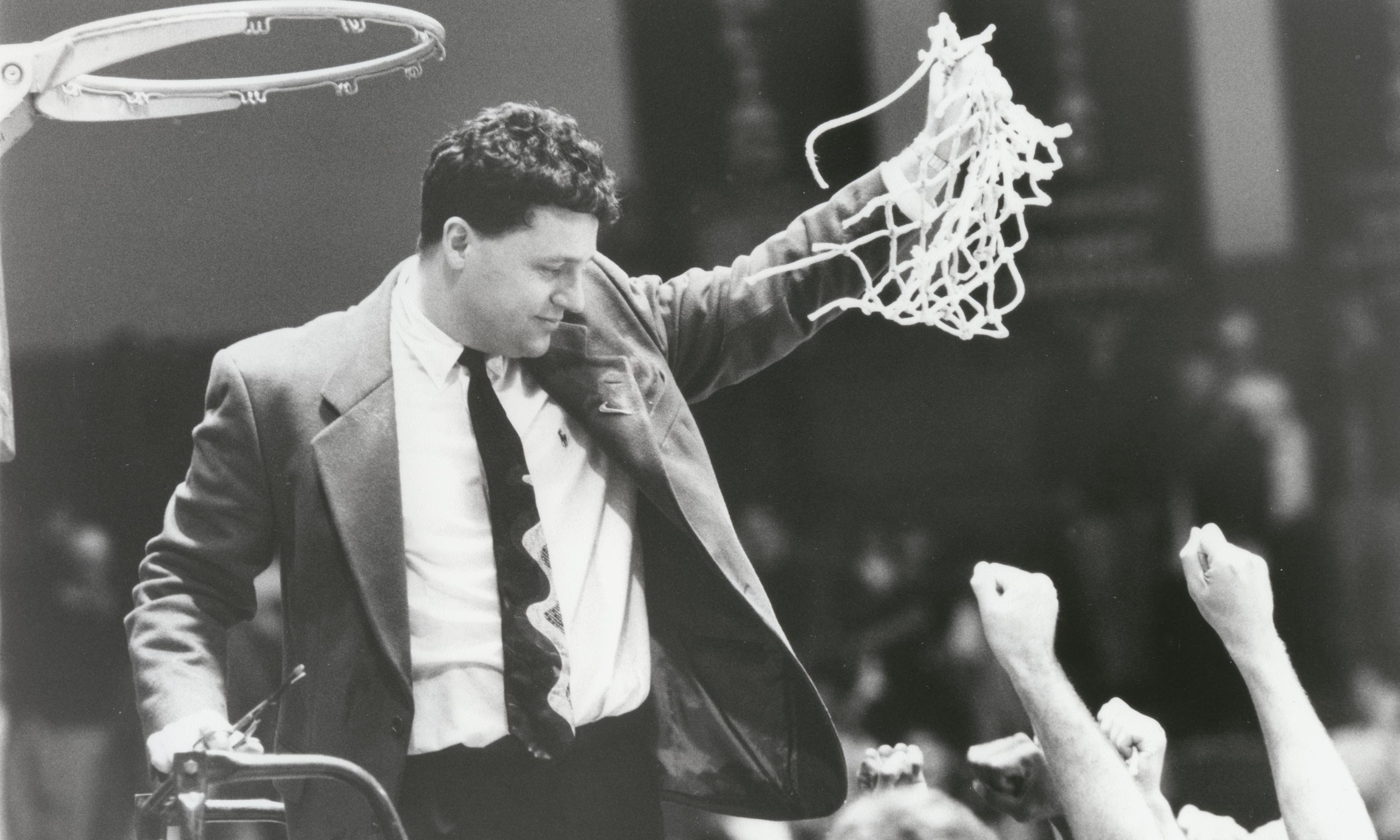 Greg Kampe in 1996 cuts down the basketball net after winning a share of the regular season GLIAC title.