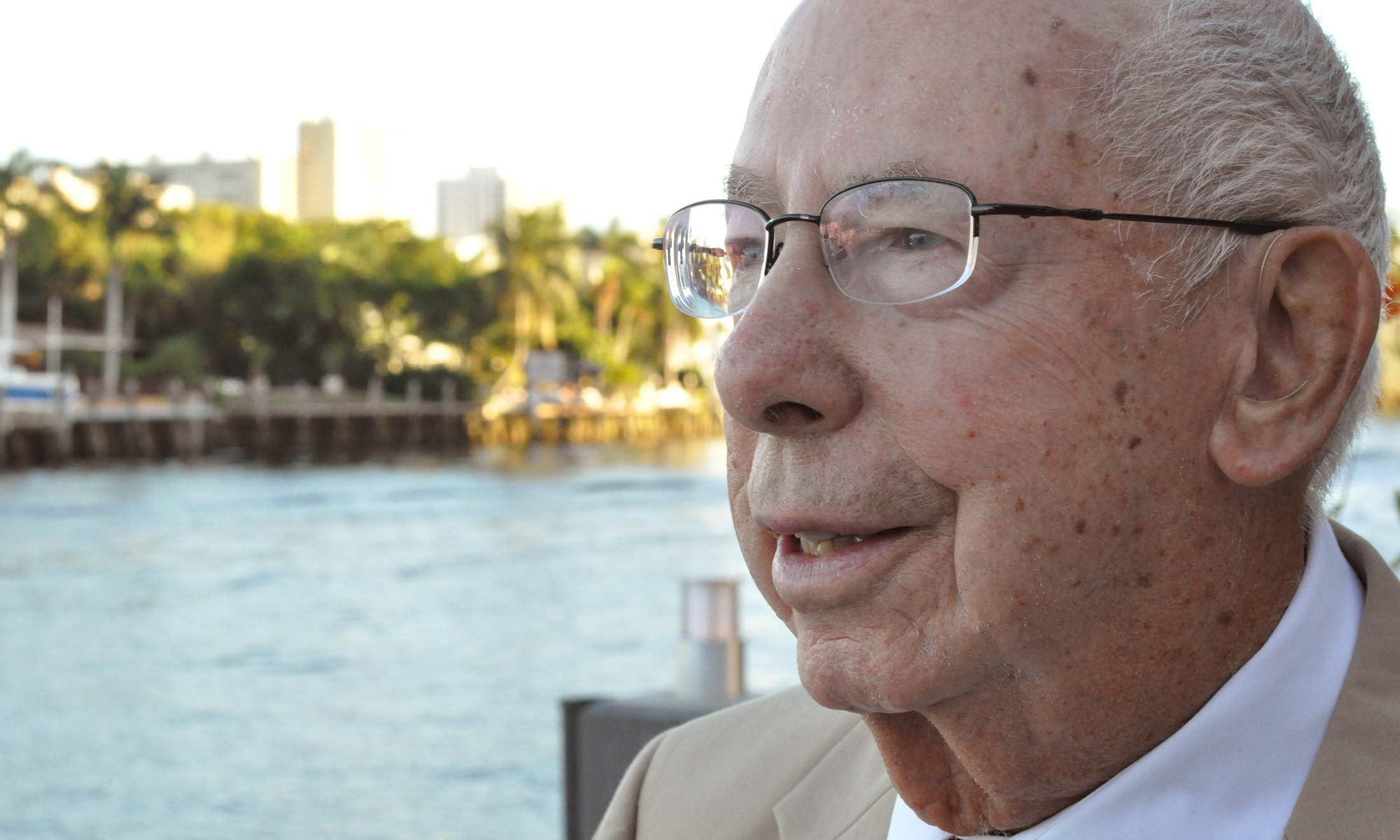 Retired Oakland University Professor Emeritus William Schwab in Fort Lauderdale, Florida. Close up of his face, standing on a dock and looking out into the water